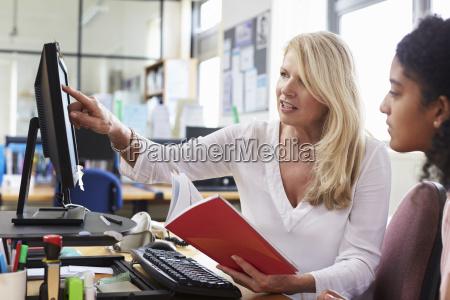 careers advisor meeting female college student
