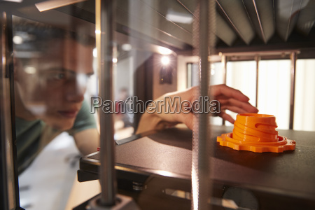 male college student printing 3d object