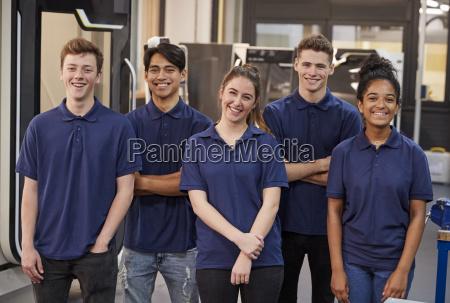 portrait of engineering apprentices in factory