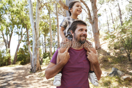daughter, riding, on, father's, shoulders, on - 25115830