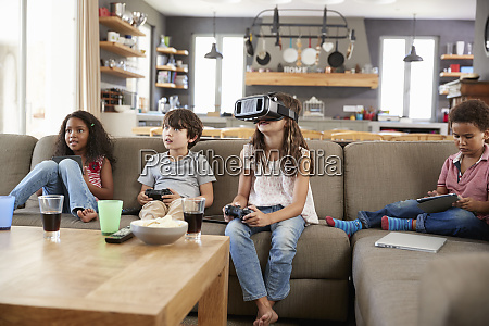 children play computer game using virtual