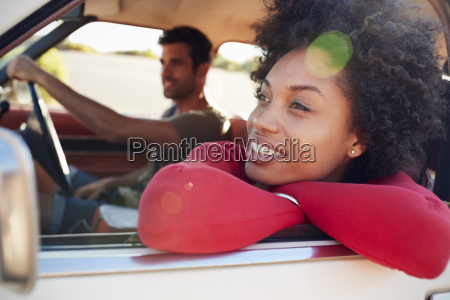 young couple relaxing in car during