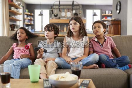 group, of, children, sitting, on, sofa - 25117520
