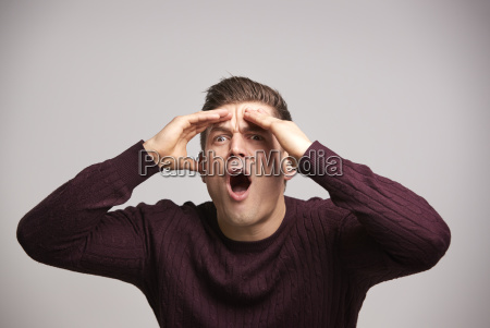 shocked young white man with hands