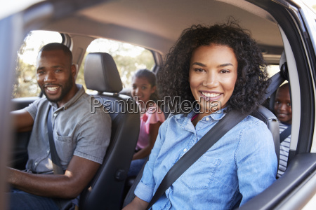young black family in a car
