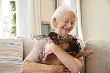 senior woman sitting on sofa at