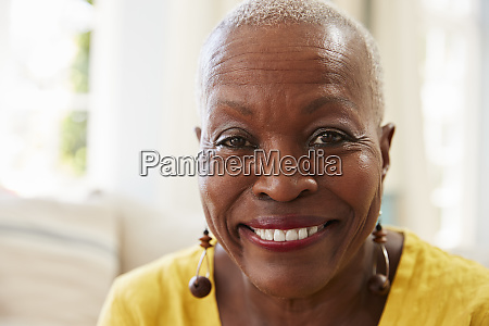 portrait of smiling senior woman sitting