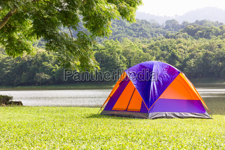 dome tent camping at lake side