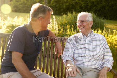 man visiting senior male relative in