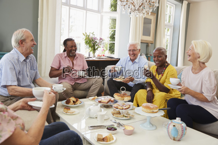 group of senior friends enjoying afternoon
