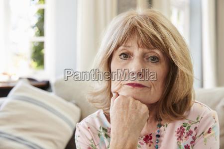 portrait of senior woman on sofa