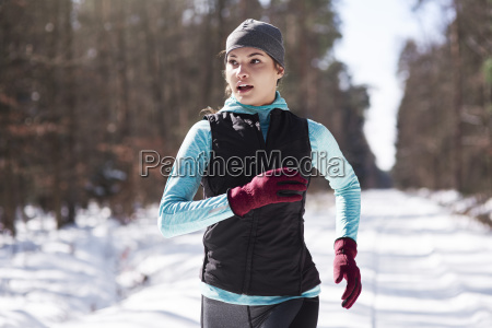 portrait of young woman jogging in
