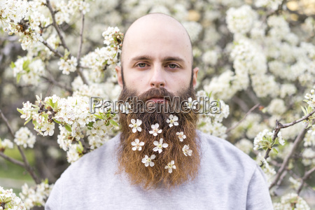 portrait of hipster with white tree