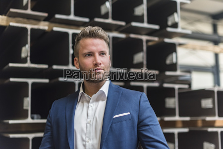 portrait of confident businessman on factory