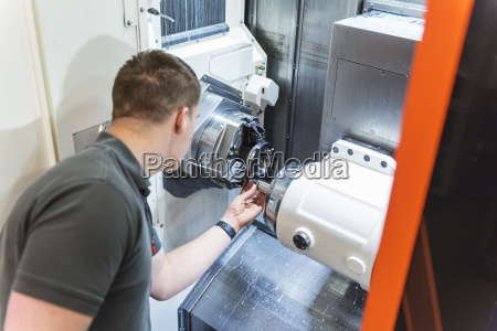 man working at machine in factory