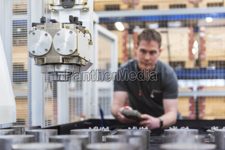 man operating machine in factory