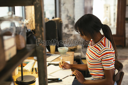 young woman working at desk in
