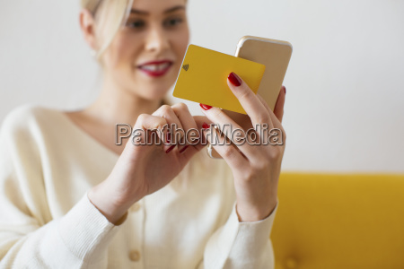 woman using smartphone and using bank