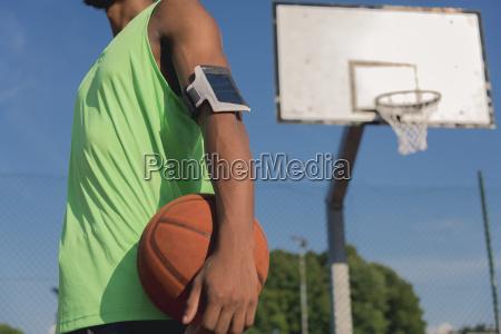 young basketball player with ball and
