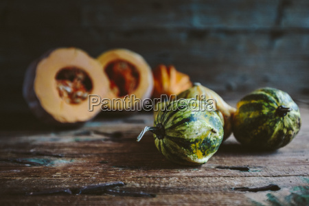 ornamental pumpkins on wood