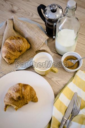 italian cornetto on plate french press