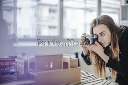 architect taking photo of architectural model