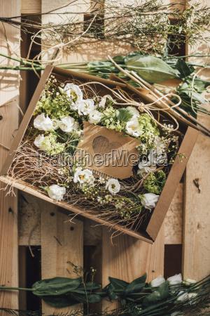 floral arrangement in cardboard box