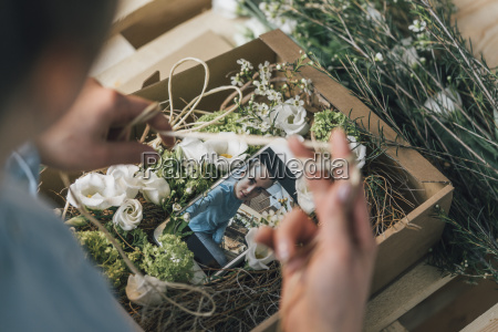 woman arranging present in a box