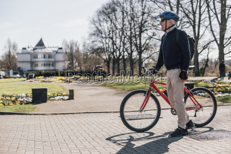 senior man with bike in a