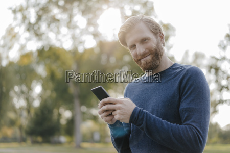 portrait of smiling man with cell