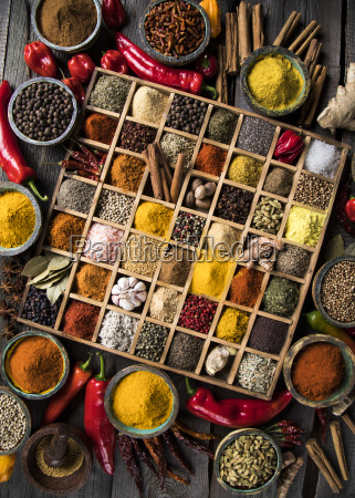assorted, spices, in, a, wooden, box - 25124588
