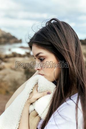 sad young woman on the beach
