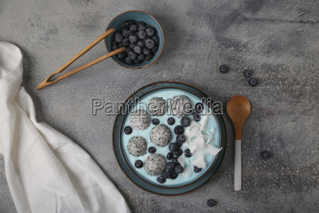 blue smoothie bowl with grated coconut