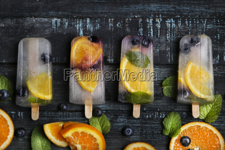 homemade detox popsicles with blueberries orange