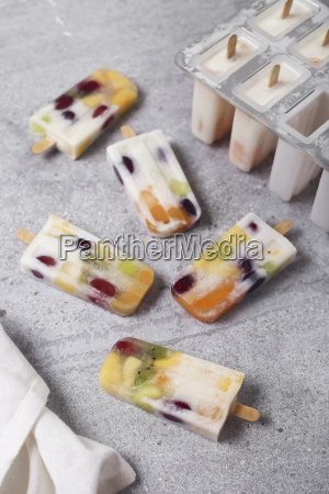 homemade fruits and yogurt ice lollies