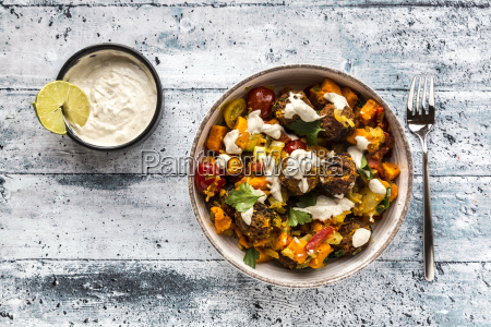 vegetarian bowl with sweet potato tomato
