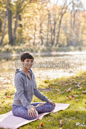 smiling mid adult woman in forest