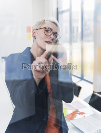 businesswoman on cell phone in office
