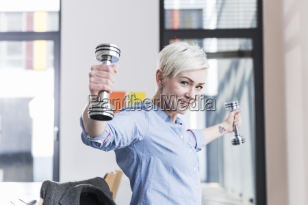 portrait of smiling woman exercising with