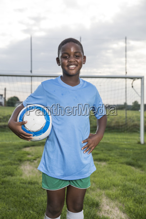 portrait of smiling young football player