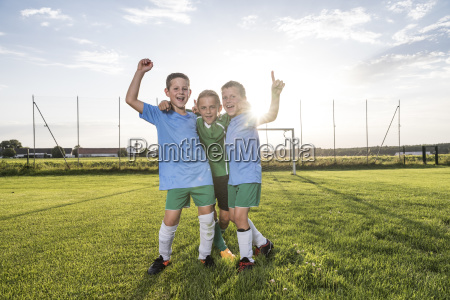 young football players cheering on football