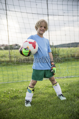portrait of smiling young football goalkeeper