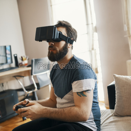 man wearing virtual reality glasses at