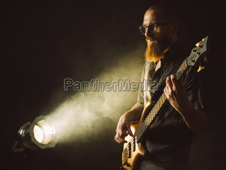 bearded, man, playing, bass, guitar, with - 25129444