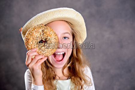 blond girl with straw hat looking