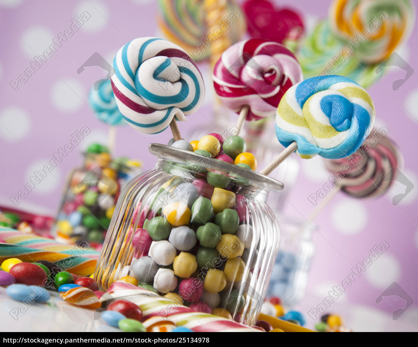 colorful, candies, in, jars, on, table - 25134978