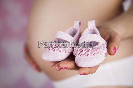 happy, pregnant, woman, , baby, shoes, in - 25134778