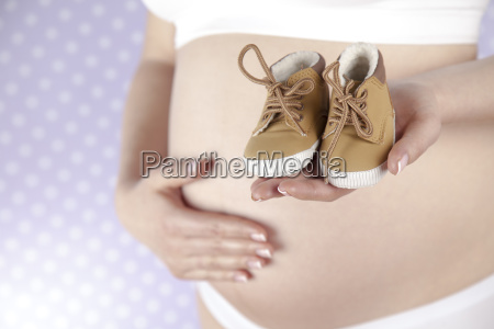 pregnant, woman, holding, baby, shoes, in - 25134868