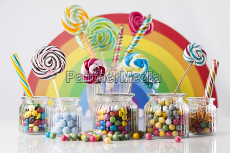 colorful, candies, in, jars, on, table - 25135136