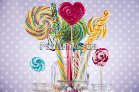 colorful, candies, in, jars, on, table - 25135148